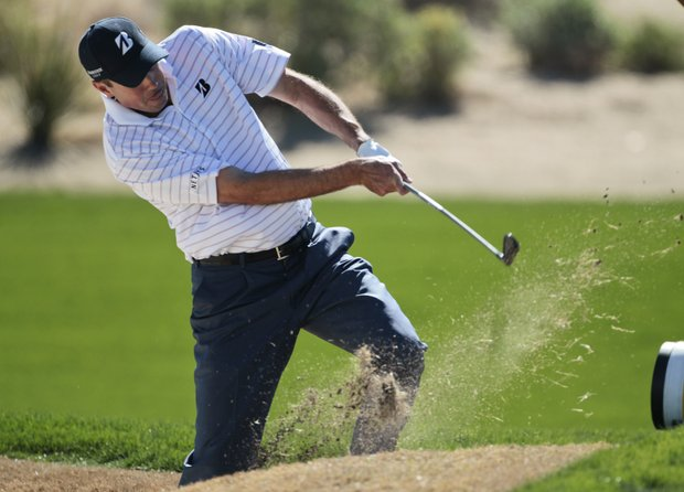 Matt Kuchar hits from the edge of the bunker on the second fairway while playing Martin Kaymer during the Match Play Championship golf tournament, Friday, Feb. 24, 2012, in Marana, Ariz.