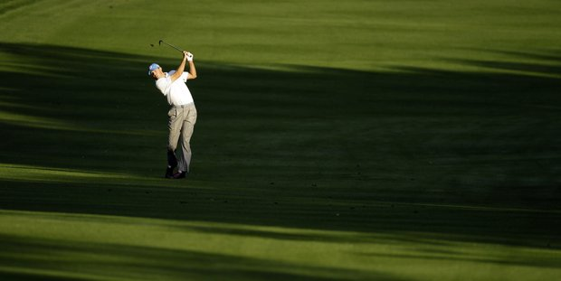 Matt Kuchar hits from the shadows along the 10th fairway during the first round of the Transitions golf tournament Thursday, March 15, 2012, in Palm Harbor, Fla.