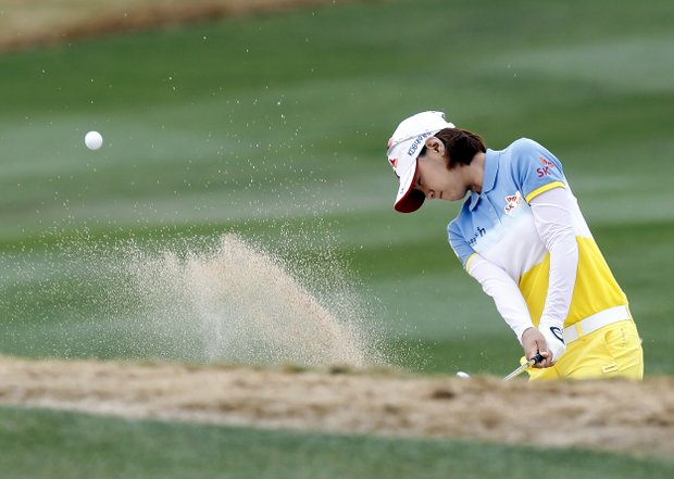 Na Yeon Choi, of South Korea, hits her second shot out of a bunker on the second hole during the third round of the Founders Cup golf tournament Saturday, March 17, 2012, in Phoenix, Ariz.