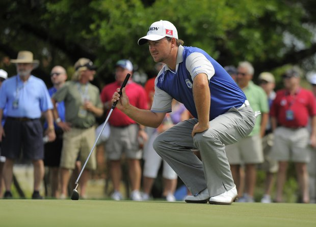 Team Lake Nona's Graeme McDowell, of Ireland, sizes up his putt on the second green during the two-day Tavistock Cup exhibition golf tournament at Lake Nona Golf & Country Club Tuesday, March 20, 2012, in Orlando, Fla.