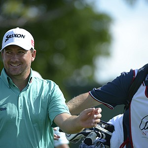 Graeme McDowell, left, of Northern Ireland, walks with his caddie down the fairway after teeing off on ninth hole during the second round of the Arnold Palmer Invitational golf tournament at Bay Hill in Orlando, Fla., Friday, March 23, 2012.