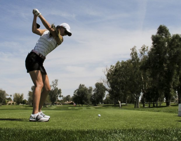 Michelle Wie hits from the 12th tee during the pro-am round of the LPGA Kraft Nabisco Championship golf tournament in Rancho Mirage, Calif., Wednesday, March 28, 2012.