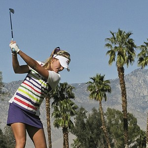 Lexi Thompson hits her tee shot on the fifth hole during the first round of the LPGA Kraft Nabisco Championship golf tournament in Rancho Mirage, Calif., Thursday, March 29, 2012.