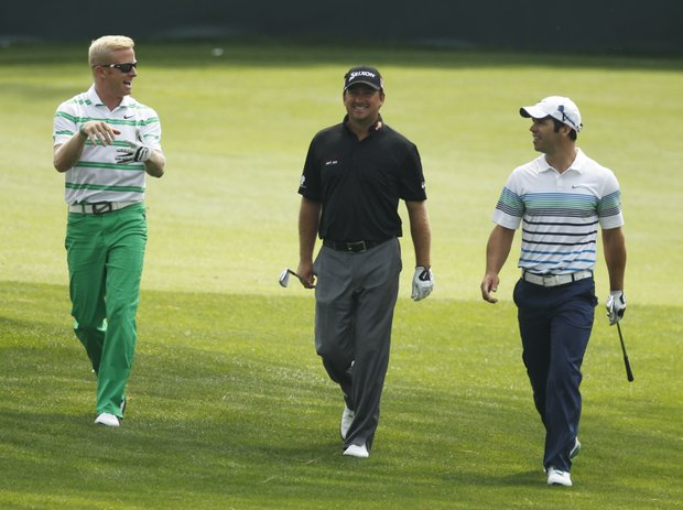From left, Simon Dyson, of England, Graeme McDowell, of Northern Ireland, and Paul Casey, of England, walk up to the 16th green during a practice round for the Masters golf tournament Tuesday, April 3, 2012, in Augusta, Ga.