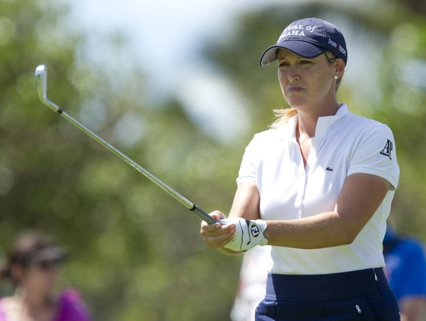 Cristie Kerr prepares to hit her drive off the 16th tee in the third round of the LPGA LOTTE Championship golf tournament at Ko Olina Golf Club, Friday, April 20, 2012, in Kapolei, Hawaii.
