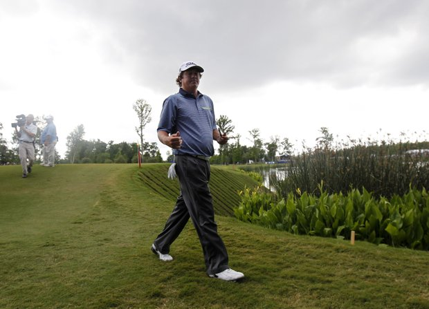 Jason Dufner walks off the ninth green during the final round of the Zurich Classic golf tournament at TPC Louisiana in Avondale, La., Sunday, April 29, 2012.