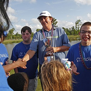 Jason Dufner meets children from St. Michaels School after winning the Zurich Classic at the TPC Louisiana course in Avondale, La., Sunday, April 29, 2012. Jason Duffner won the Zurich Classic defeating Ernie Els in a playoff.