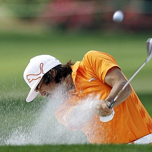 Rickie Fowler hits from a sand trap on the 16th hole during the final round of the Wells Fargo Championship golf tournament at Quail Hollow Club in Charlotte, N.C., Sunday, May 6, 2012. Fowler won the tournament on the first playoff hole.