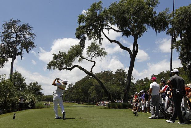 Rickie Fowler hits from the 6th tee during the first round of the Players Championship golf tournament, Thursday, May 10, 2012, at TPC Sawgrass in Ponte Vedra Beach, Fla.