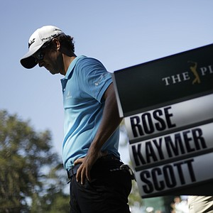 Adam Scott, of Australia, waits after paring the 15th hole during the second round of the Players Championship golf tournament at TPC Sawgrass, Friday, May 11, 2012, in Ponte Vedra Beach, Fla.