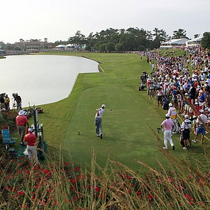 Matt Kuchar, center, tees off on the 18th hole during the final round of the Players Championship golf tournament, Sunday, May 13, 2012, at TPC Sawgrass in Ponte Vedra Beach, Fla. Kuchar won the tournament.