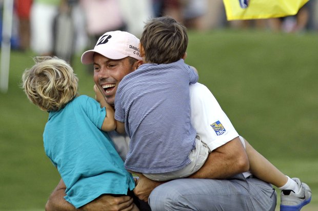 Matt Kuchar, center, hugs his sons, Carson, left, and Cameron, right, after winning The Players Championship golf tournament Sunday, May 13, 2012, at TPC Sawgrass in Ponte Vedra Beach, Fla.