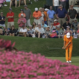 Rickie Fowler hits from the 17t green during the final round of the Players Championship golf tournament at TPC Sawgrass, Sunday, May 13, 2012, in Ponte Vedra Beach, Fla.