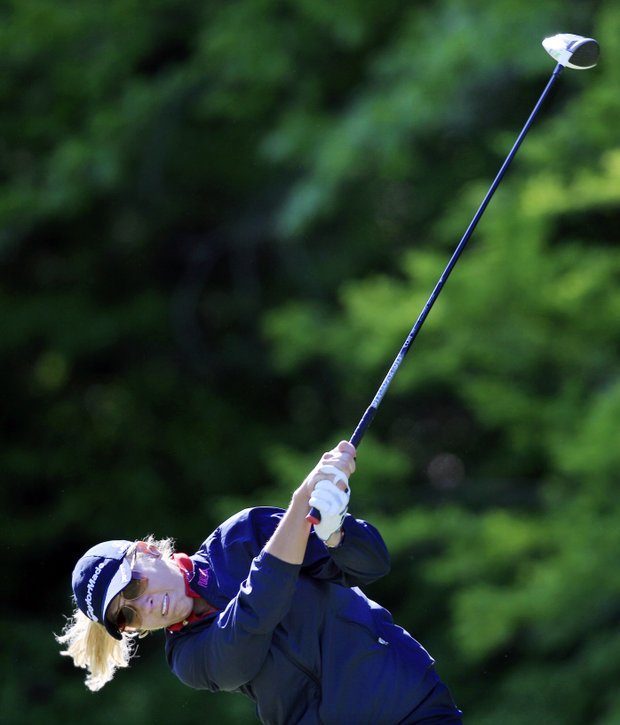 Natalie Gulbis hits a tee shot on the second hole during the first round of the Sybase Match Play Championship golf at Hamilton Farm Golf Club in Gladstone, N.J., Thursday, May 17, 2012.