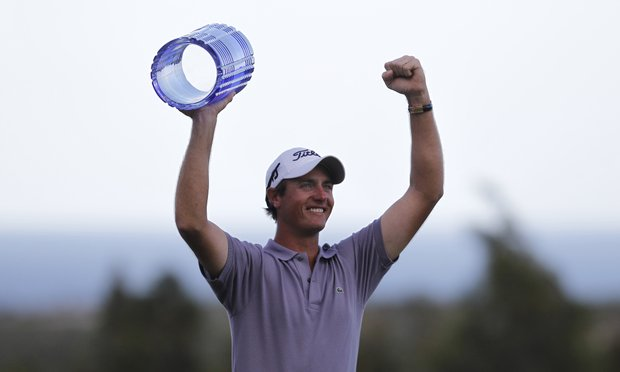Nicolas Colsaerts of Belgium holds the trophy after winning the Volvo World Match Play Golf Championship tournament final against Graeme McDowell of Northern Ireland, in Casares, southern Spain, Sunday, May 20, 2012.