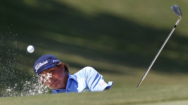 Jason Dufner hits out of a bunker onto the 16th green during the final round of the PGA Byron Nelson Championship golf tournament Sunday, May 20, 2012, in Irving, Texas. Dufner won the tournament with a four day total 11-under, 269.