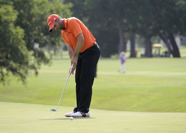 Sergio Garcia of Spain putts on the 18th green during the second round of the PGA Colonial golf tournament Friday, May 25, 2012, in Fort Worth, Texas.