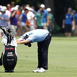 Jason Dufner stretches his back before hitting off the fairway on his approach to the ninth green during the second round of the PGA Colonial golf tournament Friday, May 25, 2012, in Fort Worth, Texas.