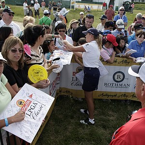 Cristie Kerr signs autographs for fans on the ninth hole during the second round of the LPGA ShopRite Classic golf competition at Stockton Seaview Hotel and Golf Club in Galloway Township, N.J., Saturday, June 2, 2012.