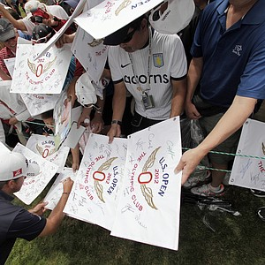 Graeme McDowell, of Ireland, signs autographs during a practice round for the U.S. Open Championship golf tournament Tuesday, June 12, 2012, at The Olympic Club in San Francisco.