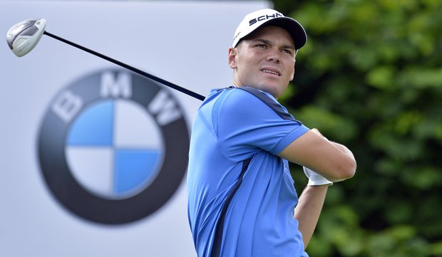 Martin Kaymer of Germany watches his shot during the first round of the BMW International Open golf at the Laerchenhof Golf Club in Pulheim, Germany, Thursday, June 21, 2012.