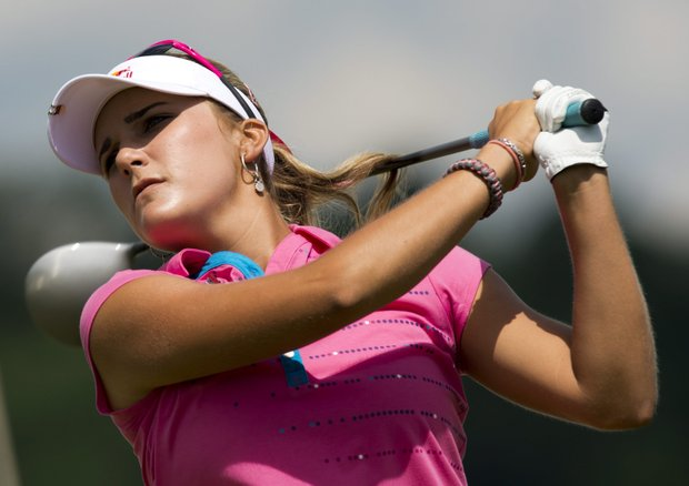 Lexi Thompson watches her drive on the 10th hole during the third round of the LPGA Classic golf tournament in Waterloo, Ontario, on Saturday June 23, 2012.