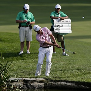 Adam Scott, of Australia, chips onto the 11th green during the first round of the AT&T National golf tournament at Congressional Country Club in Bethesda, Md., Thursday, June 28, 2012.