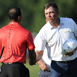 Bo Van Pelt, right, shakes hands with Tiger Woods on the 18th green after Woods won the AT&T National golf tournament at Congressional Country Club in Bethesda, Md., Sunday, July 1, 2012.
