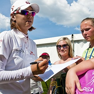 Na Yeon Choi of South Korea signs autographs after completing the final round of the LPGA NW Arkansas Championship golf tournament in Rogers, Ark., Sunday, July 1, 2012.