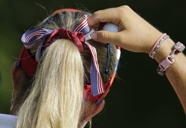 Lexi Thompson pulls a tee from her hair before teeing off the 11th hole during a practice round for the U.S. Women's Open golf tournament, Wednesday, July 4, 2012, in Kohler, Wis.