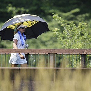 Lexi Thompson crosses the bridge over the Sheboygan River on her way to the ninth green during the first round of the U.S. Women's Open golf tournament, Thursday, July 5, 2012, in Kohler, Wis.