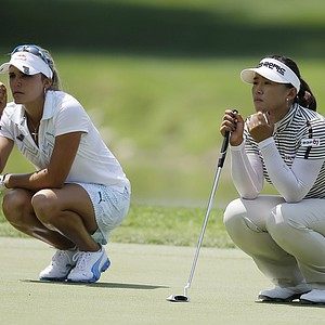Lexi Thompson, left, and South Korea's Amy Yang line up putts on the ninth green during the first round of the U.S. Women's Open golf tournament on Thursday, July 5, 2012, in Kohler, Wis.