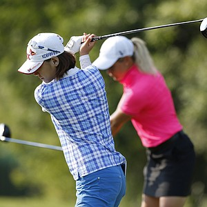 Na Yeon Choi, of South Korea, left, and Suzann Pettersen, of Norway practice their swings on the tenth hole during the second round of the U.S. Women's Open golf tournament, Friday, July 6, 2012, in Kohler, Wis.