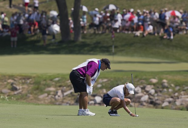 Cristie Kerr picks debris away from her ball on the ninth fairway during the second round of the U.S. Women's Open golf tournament, Friday, July 6, 2012, in Kohler, Wis.