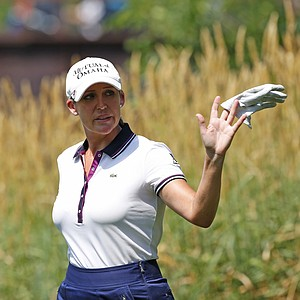 Cristie Kerr waves to fans on the 9th hole during the second round of the U.S. Women's Open golf tournament, Friday, July 6, 2012, in Kohler, Wis.