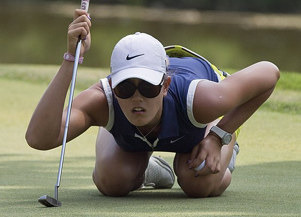 Michelle Wie lines up a putt on the ninth hole during the third round of the U.S. Women's Open golf tournament on Saturday, July 7, 2012, in Kohler, Wis.