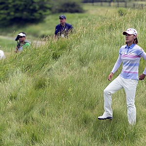 Na Yeon Choi lines up her shot from the rough along the seventh fairway during the final round of the U.S. Women's Open golf tournament on Sunday, July 8, 2012, in Kohler, Wis.