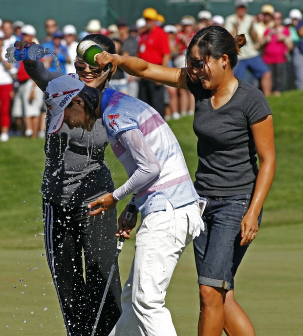 Na Yeon Choi, of South Korea, gets doused on the 18th hole after winning the U.S. Women's Open golf tournament, Sunday, July 8, 2012, in Kohler, Wis.