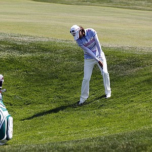 Na Yeon Choi, of South Korea, hits out of the rough on the 10th hole during the final round the U.S. Women's Open golf tournament, Sunday, July 8, 2012, in Kohler, Wis.
