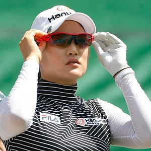 So Yeon Ryu of South Korea adjusts her sun glasses on the thirteenth hole during the second round of the Evian Masters women's golf tournament in Evian, eastern France, Friday, July 27, 2012.