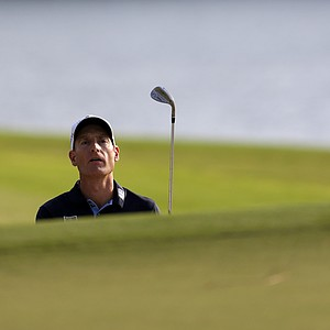 Jim Furyk looks for his ball after hitting out of the sand trap on the 17th hole during the third round of the Tour Championship golf tournament Saturday, Sept. 22, 2012, in Atlanta.