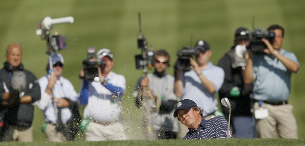 USA's Jason Dufner hits out of a bunker on the 14th hole during a foursomes match at the Ryder Cup PGA golf tournament Saturday, Sept. 29, 2012, at the Medinah Country Club in Medinah, Ill.