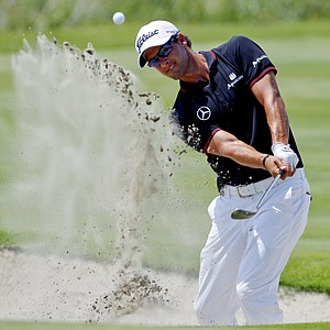 Adam Scott, of Australia, chips to the fourth green during the final round of the PGA Championship golf tournament on the Ocean Course of the Kiawah Island Golf Resort in Kiawah Island, S.C., Sunday, Aug. 12, 2012.