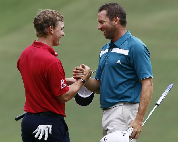 Bud Cauley, left, congratulates Sergio Garcia, of Spain, following Garcia's win of the rain delayed Wyndham Championship golf tournament in Greensboro, N.C., Monday, Aug. 20, 2012.
