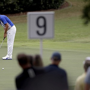 Rickie Fowler hits a putt on the ninth hole during the first round at the Tour Championship golf tournament Thursday, Sept. 20, 2012, in Atlanta.