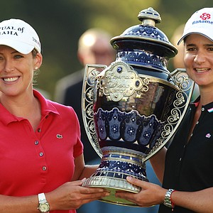 U.S. Cristie Kerr, left, receives the trophy from the Mexican former golf player Lorena Ochoa after winning the LPGA Lorena Ochoa Invitational golf tournament at the Guadalajara Country Club in Guadalajara, Mexico, Sunday, Nov. 11, 2012.