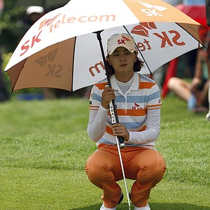 Na Yeon Choi of South Korea uses an umbrella to shield herself from the sun as she lines up her putt on the 9th green during the first round of the LPGA Malaysia golf tournament at Kuala Lumpur Golf and Country Club in Kuala Lumpur, Malaysia, Thursday, Oct. 11, 2012.