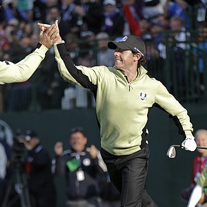 Europe's Rory McIlroy is congratulated by teammate Graeme McDowell after chipping in to win the fourth hole during a foursomes match at the Ryder Cup PGA golf tournament Friday, Sept. 28, 2012, at the Medinah Country Club in Medinah, Ill.