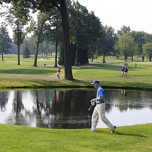 Jim Furyk walks past a lake to the third green during the second round of the Bridgestone Invitational golf tournament at Firestone Country Club, Friday, Aug. 3, 2012, in Akron, Ohio.