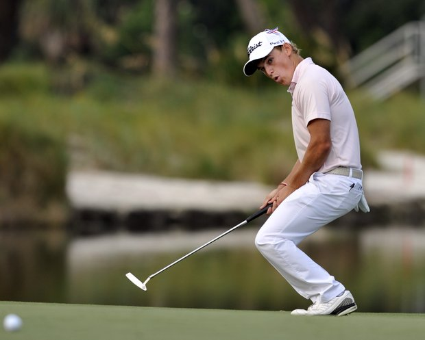Bud Cauley reacts after missing a birdie putt on the 18th green during the first round of The McGladrey Classic PGA Tour golf tournament, Thursday, Oct. 18, 2012, in St. Simons Island, Ga.